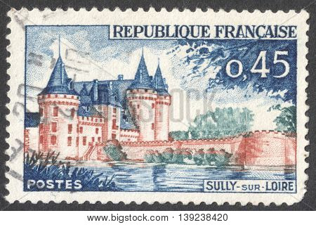 MOSCOW RUSSIA - CIRCA JANUARY 2016: a post stamp printed in FRANCE shows a view on the Sully-sur-Loire Chateau Loiret the series