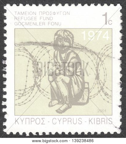 MOSCOW RUSSIA - CIRCA JANUARY 2016: a post stamp printed in CYPRUS shows a child and barbed wire circa 2001