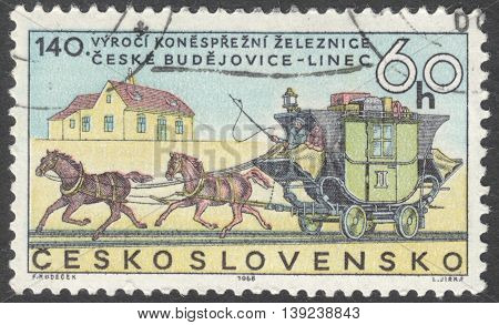 MOSCOW RUSSIA - JANUARY 2016: a post stamp printed in CZECHOSLOVAKIA shows stagecoach on rails the series