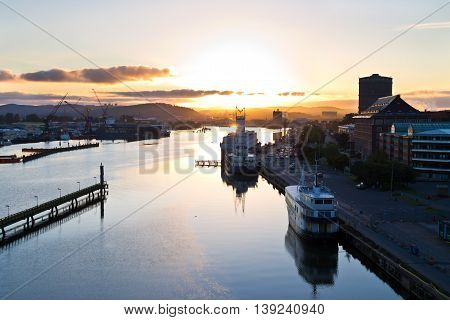 Beautiful view over the harbour of Gothenburg at sunrise. The city, located at the swedish coast, is a popular summer tourist destination.