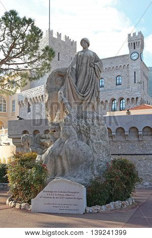 MONACO CITY MONACO - JANUARY 18: Monument Hommage des Colonies Etrangeres in Monaco on JANUARY 18 2012. Statue Tribute to Foreign Colonies in Front of the Prince Palace in Monaco City Monaco.