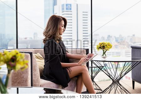Pretty businesswoman using tablet stock watch location public.