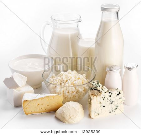 Different milk products: cheese cream, milk, yoghurt. On a white background.