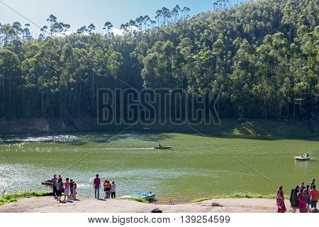 KERALA, INDIA - AUGUST 29, 2015: Tourists at the Echo point, a tourist spot near Munnar, Kerala, India
