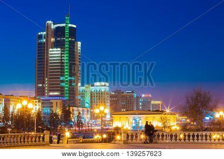 Minsk, Belarus - March 10, 2015: Business Center Of Minsk At Night Scene Street. Buildings, Downtown In Town Centre, Belarussian Capital, Belarus