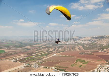 Skydiver fly above the Jezreel Valley in Israel.