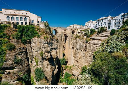 The New Bridge or Puente Nuevo Is The 120-metre-deep Chasm That Carries The Guadalevin River And Divides City Of Ronda, Province Of Malaga, Spain. Famous Landmark