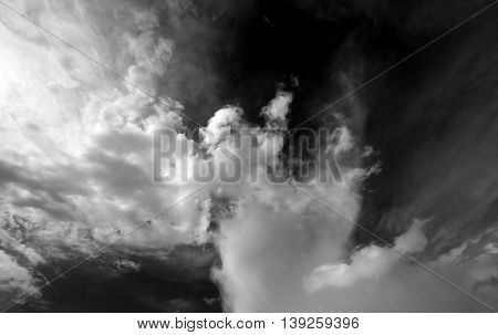 Black and white sky with clouds. Wide-angle view.