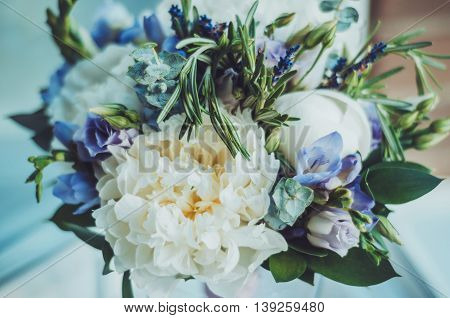 Beautiful summer wedding bouquet, abstract background. Bridal white peony flowers with blue fresia, lavander, eustoma. Rustic style, still life. Holiday floristic concept. Pastel colors wallpaper. Floral decoration. Selective focus. Text, copy space. poster