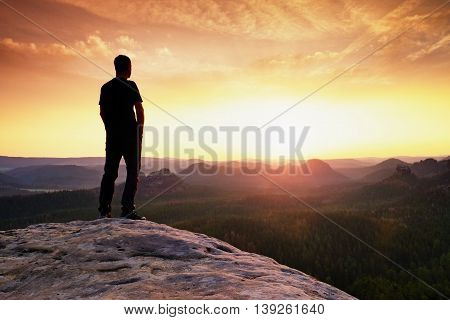 Tall Hiker Has His Hands On Hips. Thinking Man Silhouette In Nature