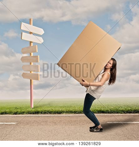 young woman holding a card box. Moving concept