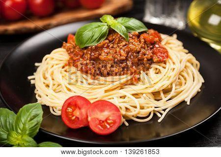 Spaghetti bolognese on dark background