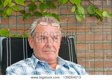 Senior Man Sitting Outside In Deeps Thoughts