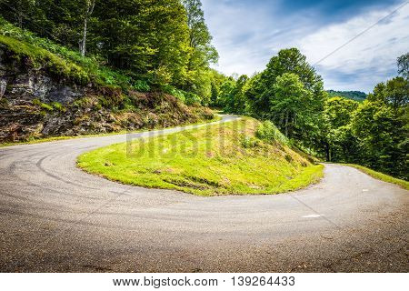 Winding Road With Sharp Curve Going Up The Mountain