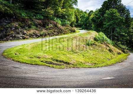 Winding Road With Sharp Bend Going Up The Mountain