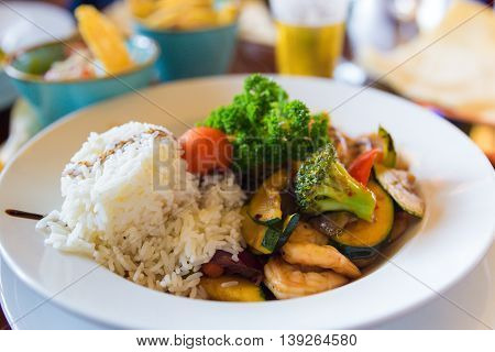 White Rice With Scampis And Vegetables In A Soy Sauce