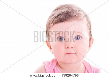 Beautiful serious baby girl on white background.