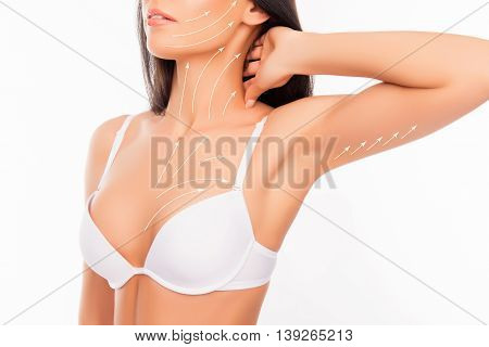 Shapely Young Woman With Perfect Chest And Hands With The Drawing Arrows Wearing White Bra, Touching