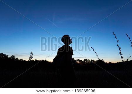 Man looks at the sky hopefully - Refugee
