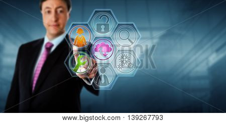 Business man touching managed service tool icons on a virtual screen. Business metaphor and internet concept for services management outsourcing data backup virtualization and technical support.