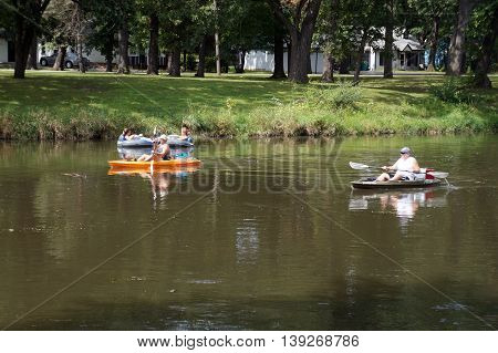 SHOREWOOD, ILLINOIS / UNITED STATES - AUGUST 30, 2015: People ride kayaks and rafts down the Du Page River in Shorewood.