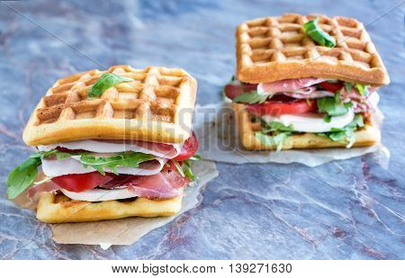 Waffle sandwiches on the table, selective focus
