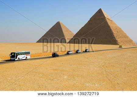 Egyptian pyramids in Giza. Giza, Egypt - February 1, 2009: Tourist visiting the most famous Egyptian pyramids in Giza, Egypt. It is the only one of the Seven Wonders of the Ancient World.