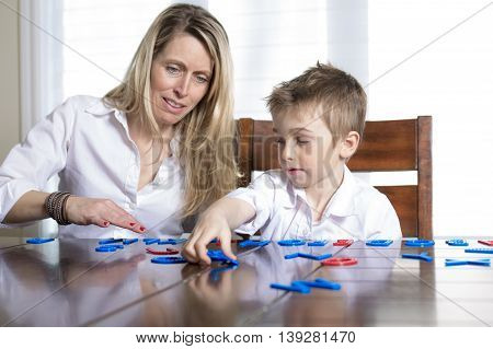 Mother and son at home play together. The idea and concept of the school, school, home education and developmental activities.