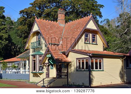 Auckland New Zealand - July 16 2016: The Historic Visitors' centre and restaurant buildings on Auckland's most popular tourist attraction - One Tree Hill in Cornwall Park New Zealand.