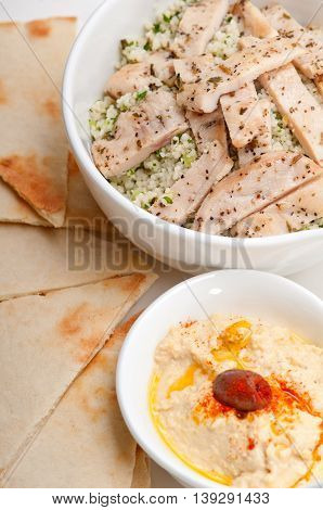 close up image of chicken taboulii couscous with hummus