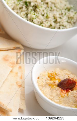 close up image of taboulii couscous with hummus