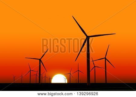 wind turbines silhouettes at dusk with sun in background