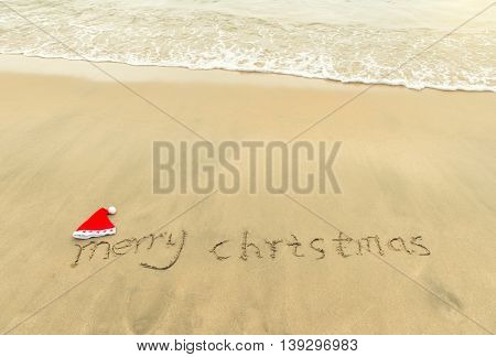 Merry Christmas written on tropical beach