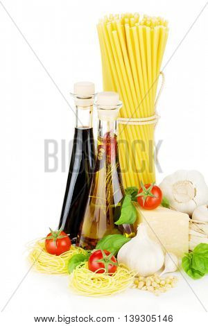 Pasta, tomatoes, basil, olive oil, vinegar, garlic and parmesan cheese. Isolated on white background