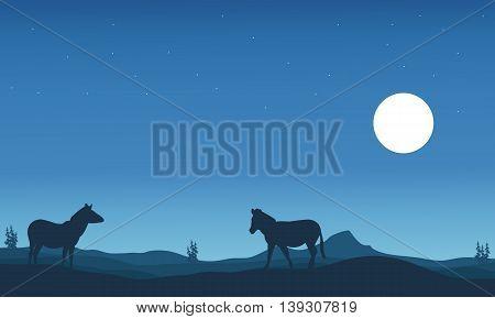 Two zebra silhouettes in hills landscape vector illustration