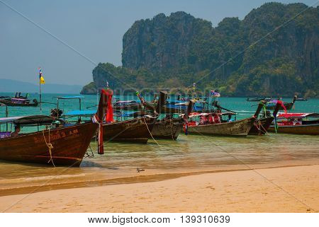Peninsula Of Railay. Wooden Boat. Rock. Krabi, Thailand.