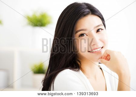 close up smiling young asian woman face