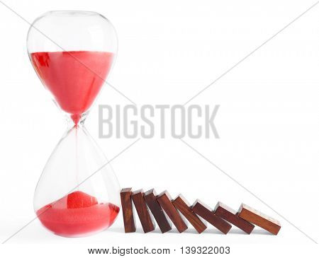 Red hour glass and dominoes, isolated on white
