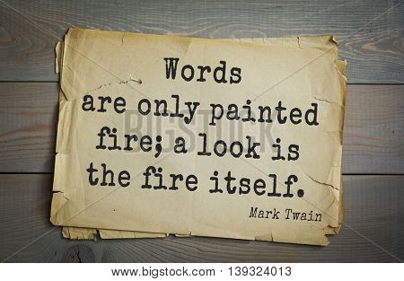 American writer Mark Twain (1835-1910) quote.  Words are only painted fire; a look is the fire itself.