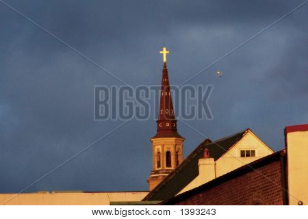 Church steeple stands over downtown