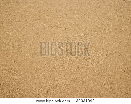 Texture of the brown cement wall for background.