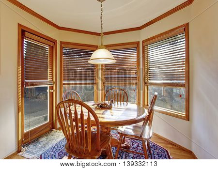 Cozy Dining Area With Wooden Table Set And Rug