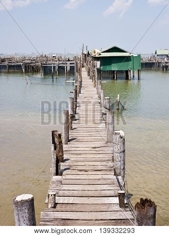 Old bridge to the sea at Songkla Province Thailand.