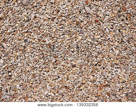 Pale of crushed stone background and texture.