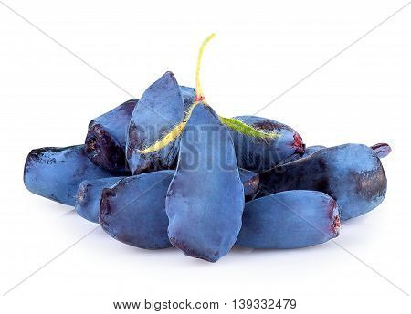 Fresh honeysuckle blue berry fruits isolated on white background. Honeysuckle woodbine lonicera closeup