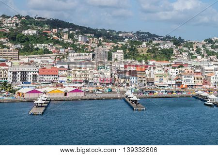FORT DE FRANCE, MARTINIQUE - NOVEMBER 2015 : Landscape of Fort-de-France Martinique harbor, piers, city and mountains.