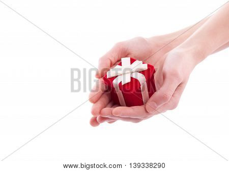 Hands holding heart close up, isolated on white