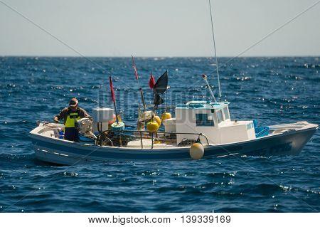 Palamos, Catalonia may 2016: Fishing boat fishing in open sea