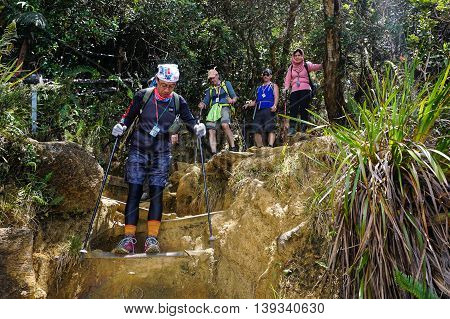 Ranau,Sabah,Malaysia-March 13,2016: Group of climbers move down from Laban Rata to Timpohon gate after successfully completed conquering the mountain Kinabalu at Ranau Sabah Borneo on 13th March 2016.