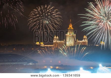 Moscow State University, Luzhniki stadium and fireworks at night in Moscow, Russia